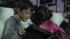 4K Brother and sister learning together on computers Stock Footage