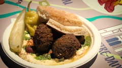 Lemon squeeze on Falafel and Pita - Slow Motion Stock Footage