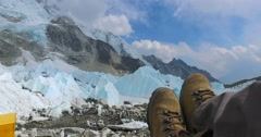 Tourist feet on the background of the Everest Base Camp on the glacier Khumbu. Stock Footage