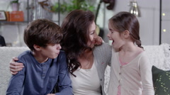4K Mother hugging and spending time with her two children Stock Footage