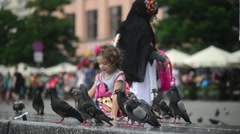 Children And Doves At The Street Of Krakow Poland, Market square Stock Footage