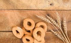 Taralli on the wood table,Traditional Italian snack from Puglia Stock Photos