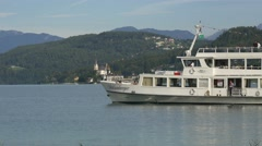 Small passenger ship in Worthersee with people onboard Stock Footage