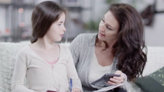 4K Mother and daughter doing homework together Stock Footage