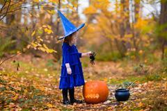 Little girl on Halloween trick or treat Stock Photos