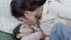 4K Loving mother kissing and hugging her son Stock Footage