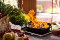 Flames in pan. Stock Photos