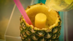 Pouring a pineapple cocktail - Slow Motion Stock Footage