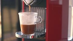 Espresso coffee drip from Nespresso machine - Slow Motion Stock Footage