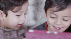 4K 2 cute boys playing on a mobile games console Stock Footage