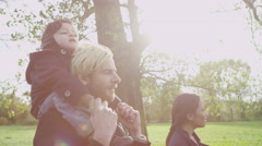 4K Family enjoying a stroll in the fresh autumn air Stock Footage