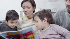 4K A mother reads her children a bedtime story Stock Footage