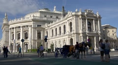 Coach with two horses and coachman in front of Burgtheater Stock Footage