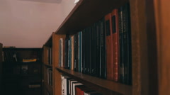 Library Shelves With Books Stock Footage