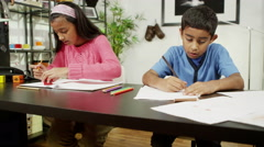 4K Brother and sister at home, writing and drawing with lots of colored pencils Stock Footage