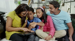 4K Happy family spending time together using a digital tablet Stock Footage