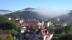 Buildings Surrounded by a Mountainous Region Stock Footage