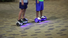 Young boys playing around on hoverboards Stock Footage