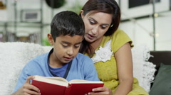 4K A mother teaches her son how to read Stock Footage