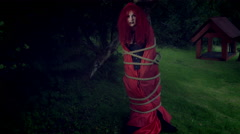 4k Halloween Shot of Red Riding Hood Tied with Ropes and Screaming Stock Footage