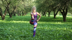 Woman performing yoga in the park Stock Footage
