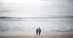 Mother and Son on Beach in Pacific Ocean California 4k Stock Video Stock Footage