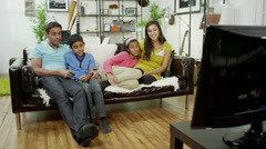 4K Happy Asian family relaxing at home, watching TV together Arkistovideo