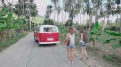 Hippie Girls Waving Their Hands to Leaving Minivan. Slow Motion Stock Footage
