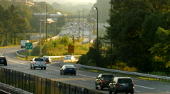 Beltway traffic long lens day Stock Footage