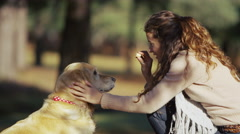 4K Teaching obedience to her pet dog Stock Footage