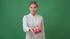 Woman giving a gift Stock Footage