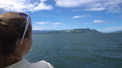 Young woman on ferry looking at Toba lake in North Sumatra, Indonesia. Stock Footage