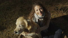 4K Portrait of an attractive young woman and her dog in the forest Stock Footage