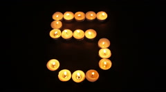 Tealight Candle Number Five Stock Footage