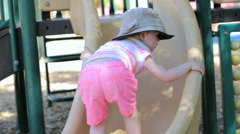 Toddler playing at outdoor playground. Stock Footage