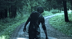 Zombies are walking through the woods. Stock Footage