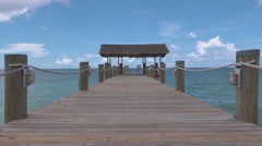 Long wood pier with 2 chairs Stock Footage