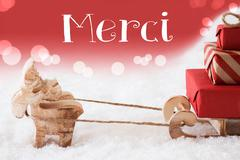 Reindeer With Sled, Red Background, Merci Means Thank You Stock Photos