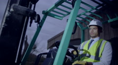 Close up of a forklift truck driver manoeuvring his truck Stock Footage