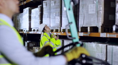 Workers in reflective clothing and hard hats are checking stocks Stock Footage
