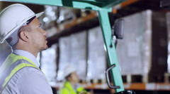A forklift truck driver Stock Footage