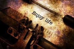 Enjoy life text on vintage typewriter Stock Illustration