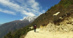 The porter carries a load a track to the base camp of Mount Everest. Stock Footage