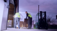 2 industrial workers are walking down a narrow dark aisle Stock Footage
