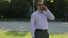A happy young man finishing a phone call Stock Footage