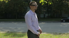 A young businessman in glasses making a phone call Stock Footage