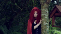 4k Halloween Shot of Red Riding Hood Hiding above Tree Stock Footage