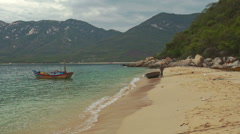 Sand Beach Wave Surf Small Boats in Azure Sea Bay in Vietnam Stock Footage