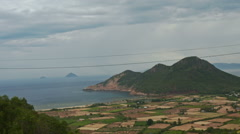 View of Separated Rural Peasant Fields against Sea Hill Stock Footage