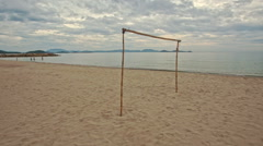 Motion Close to Volleyball Net on Empty Sand Beach Stock Footage